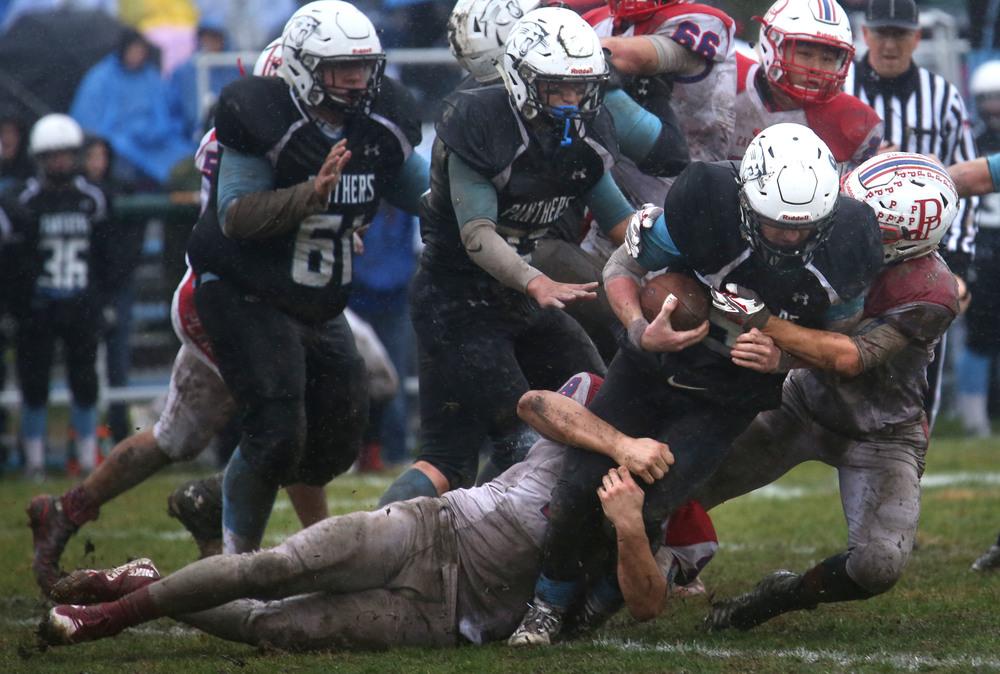North Mac quarterback Brennan White prepares to get taken down by Cardinals defender on a first quarter run. David Spencer/The State Journal-Register