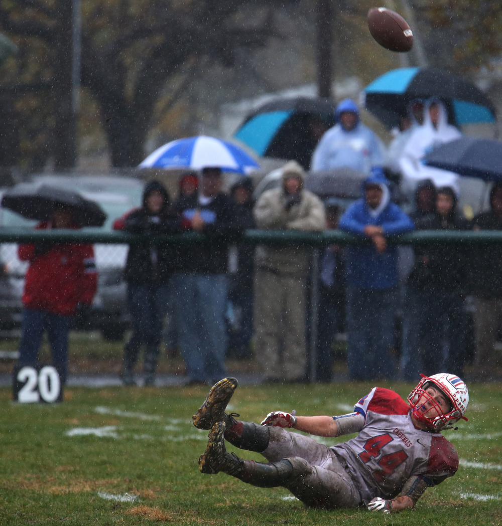 Intended Cardinals receiver Nik Samson lost his footing while trying to snag a pass early in the game. David Spencer/The State Journal-Register