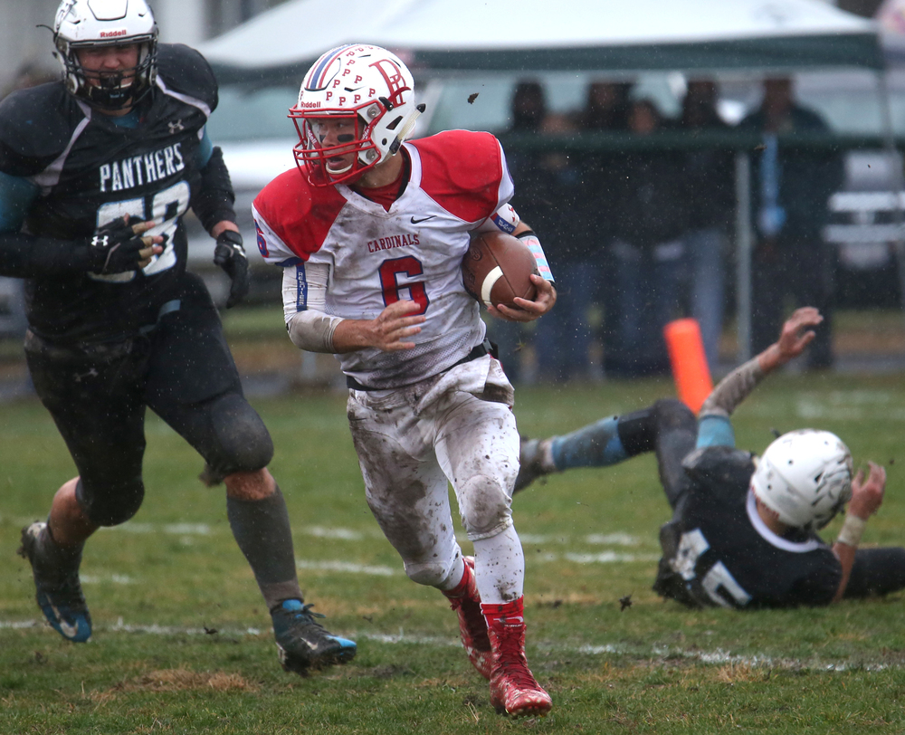 Cardinals quarterback Jacob Cronister evades the Panthers defense to pick up some yardage early in the game. David Spencer/The State Journal-Register