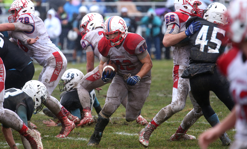 Cardinals ball carrier Nik Georges finds an opening. David Spencer/The State Journal-Register