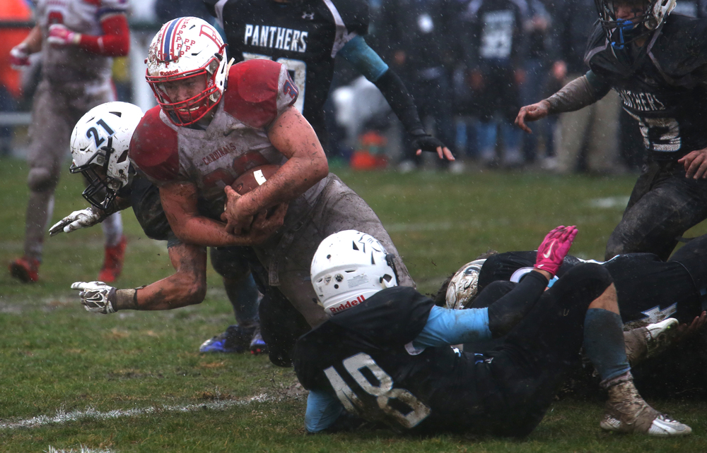 Cardinals ball carrier Logan McBride runs into several Panther defenders.David Spencer/The State Journal-Register
