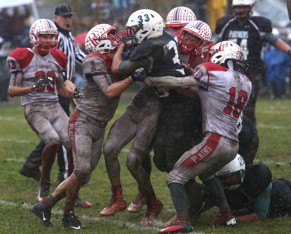 North Mac ball carrier Griffin Hatalla tries to hold onto the ball while surrounded by Cardinals defenders. A penalty was assessed on the play.David Spencer/The State Journal-Register