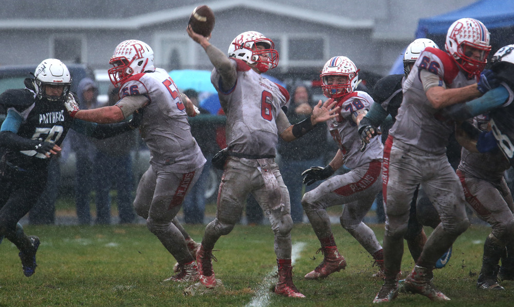 Cardinals quarterback Jacob Cronister connected on this pass to Cole Greer in the fourth quarter. David Spencer/The State Journal-Register