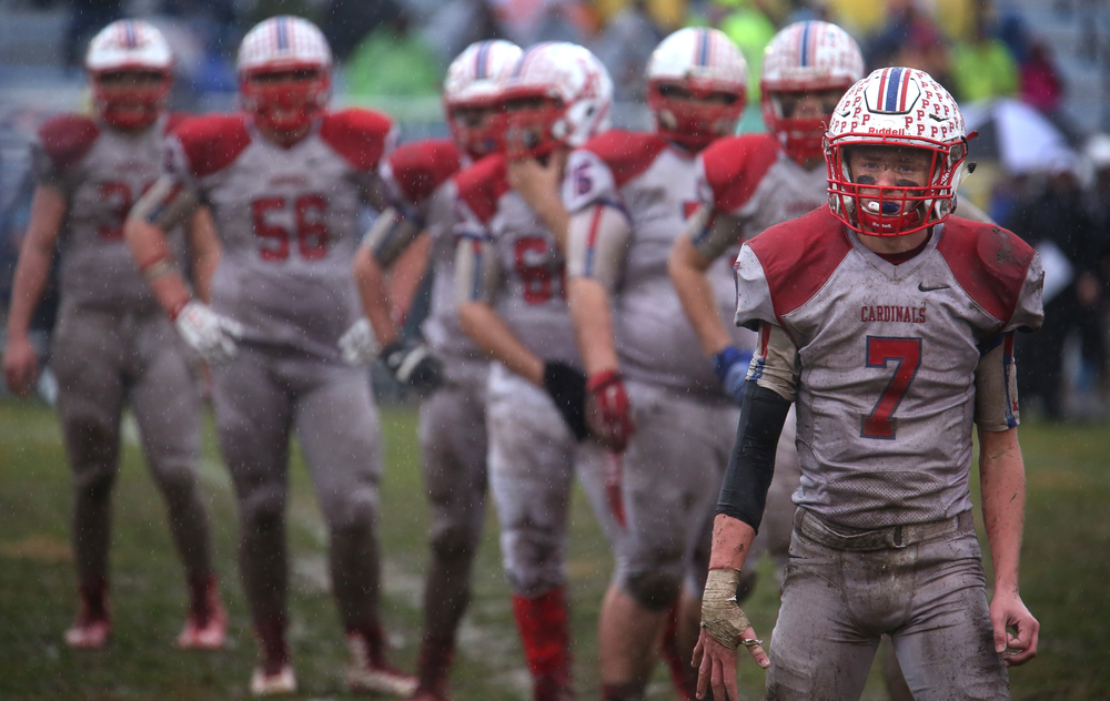 Cardinals players including #7 Kai Carlberg at right look for coaching directions on the sidelines in the fourth quarter. David Spencer/The State Journal-Register