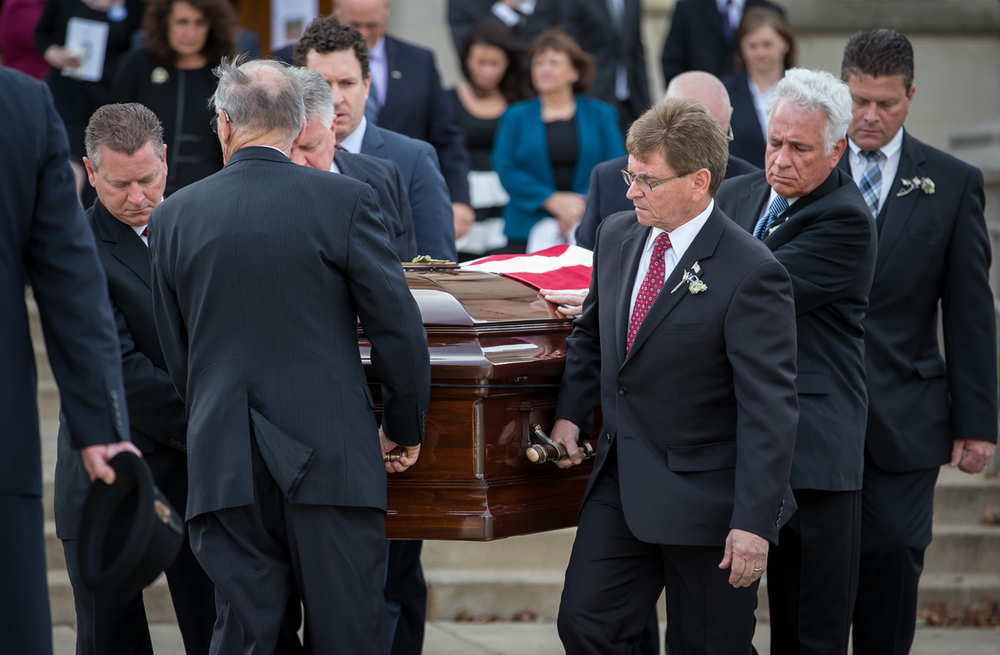 Springfield Mayor Jim Langfelder, center, along with his siblings Josh Langfelder, left, Joe Langfelder and Jay Langfelder, right, serve as pallbearers for their father, former Springfield Mayor Ossie Langfelder, after his funeral Mass at Blessed Sacrament Catholic Church, Monday, Oct. 26, 2015, in Springfield, Ill. Justin L. Fowler/The State Journal-Register
