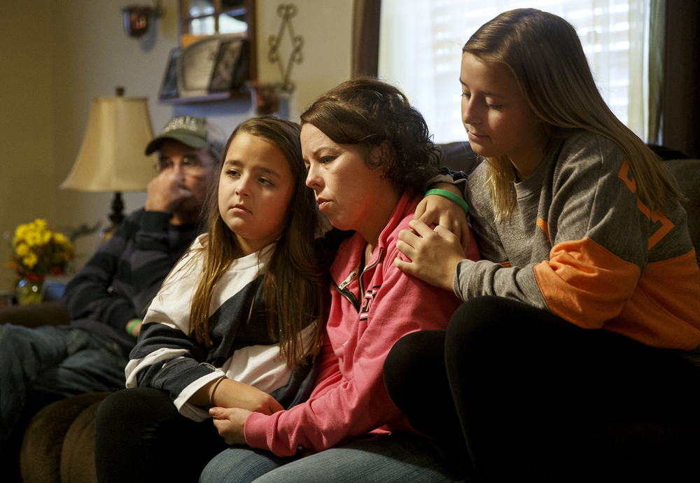 Tracy Creason talks about her late husband Roger while seated next to her daughters Randi, left, and Catlynn Wednesday, Oct. 28, 2015. Roger died Monday after being injured while working in a pipe at the Springfield Metro Sanitary District's Sugar Creek. Ted Schurter/The State Journal-Register