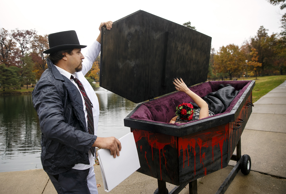 Dennis Reed closes the lid on the casket where Amanda Jones rests as her husband-to-be Jake Bryant pulls up in a hearse to their Halloween day wedding at Washington Park Saturday, Oct. 31, 2015. Ted Schurter/The State Journal-Register