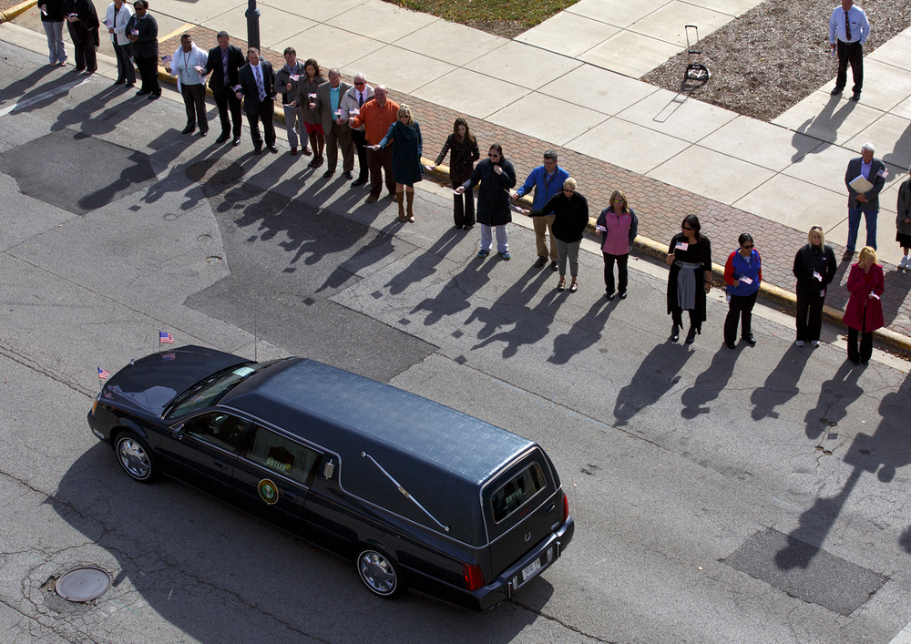The Ossie Langfelder funeral procession passes the Municipal Center where city employees lined the street Monday, Oct. 26, 2015. Rich Saal/The State Journal-Register