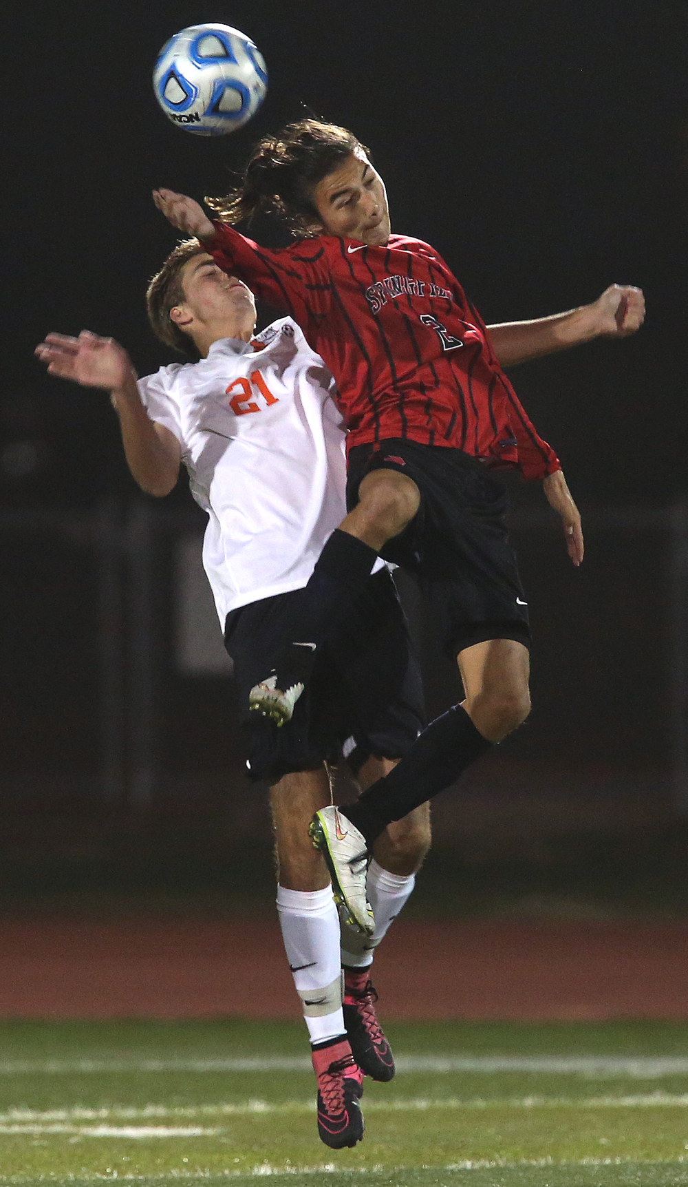 Going after a header are Springfield player Nate Cheung and Waterloo's Drew Marshall in the second period. David Spencer/The State Journal-Register