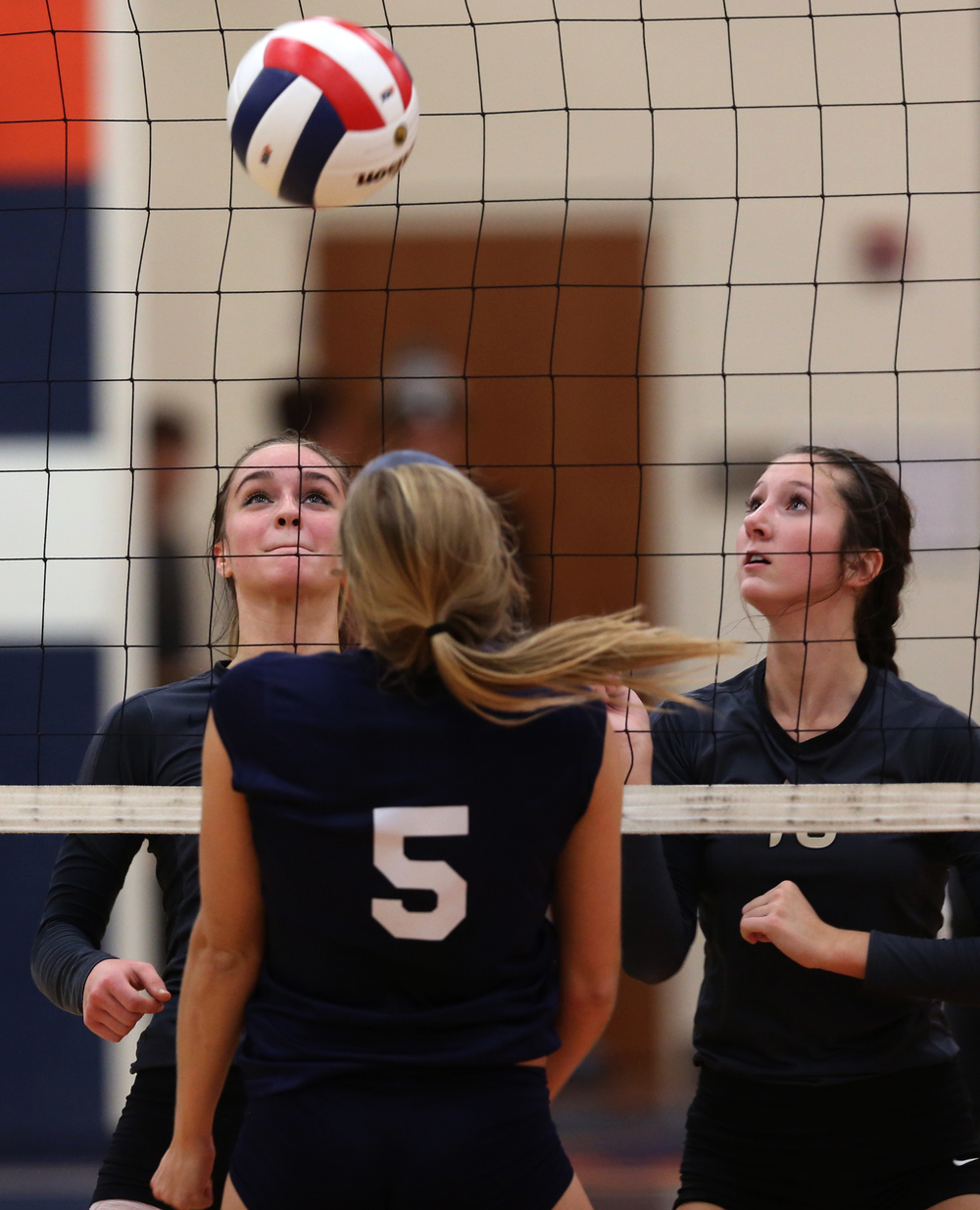 Cyclones players Emma Hopkins at left and Megan Lewis watch the ball get jammed up into the net on the Raiders side in the first game. David Spencer/The State Journal-Register