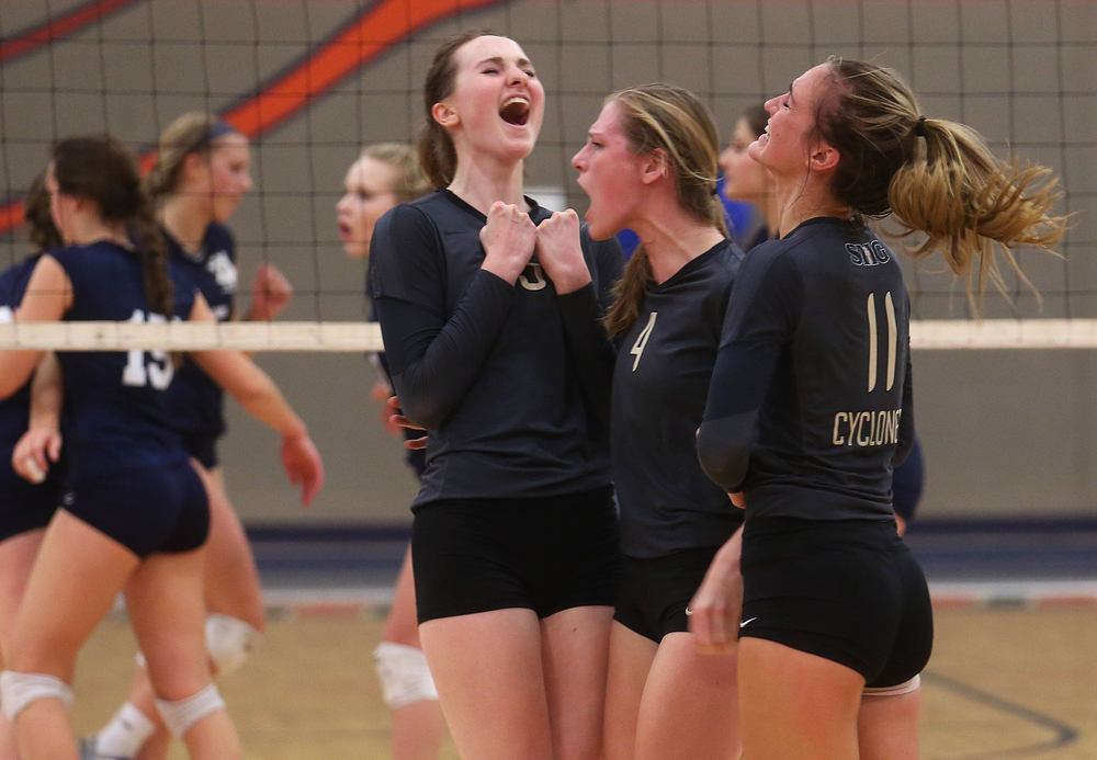 Cyclones players celebrate a point including Megan Lewis at left, Delaney Jordan at center and Emma Hopkins.  David Spencer/The State Journal-Register