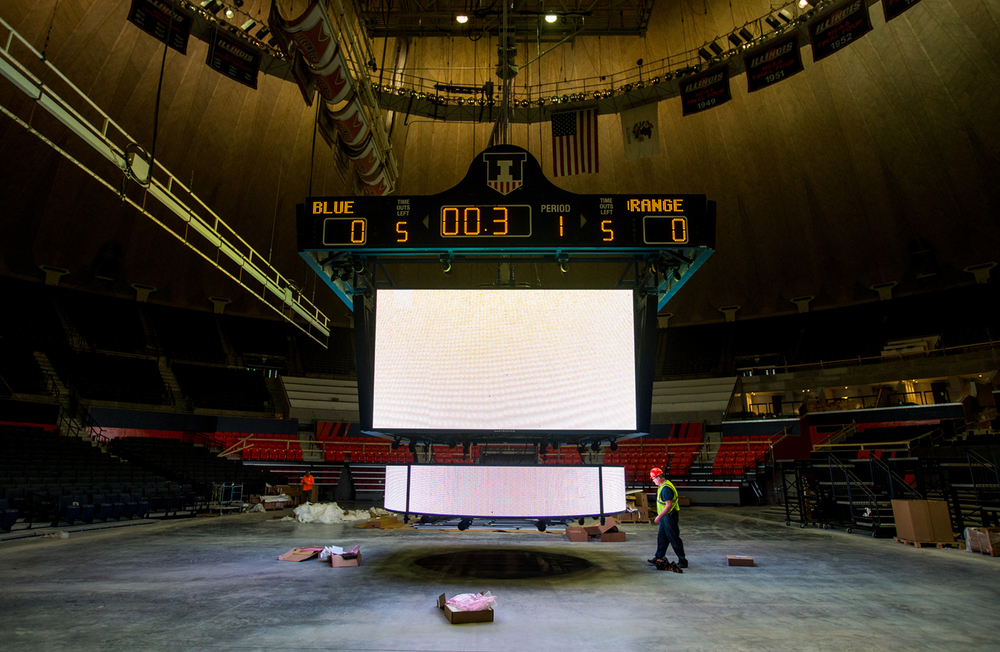 Workers put some of the finishing touches on the custom-designed high-definition LED video board that will be suspended above center court as Phase Four of the renovations continue at the University of Illinois' State Farm Center, Thursday, Nov. 5, 2015, in Champaign, Ill. The nearly $170 million project will be close to finishing Phase Four in time for the Illini to take on Notre Dame on Dec. 2. The completed renovations to the arena are expected to be finished by November of 2016. Justin L. Fowler/The State Journal-Register