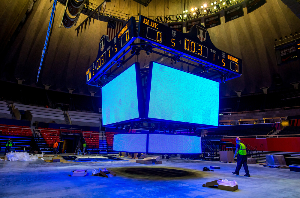 Workers put some of the finishing touches on the custom-designed high-definition LED video board that will be suspended above center court as the renovations continue at the University of Illinois' State Farm Center, Thursday, Nov. 5, 2015, in Champaign, Ill. The new lower arena bowl will feature seating for the student section, known as the Orange Krush, on three sides of the court. Justin L. Fowler/The State Journal-Register