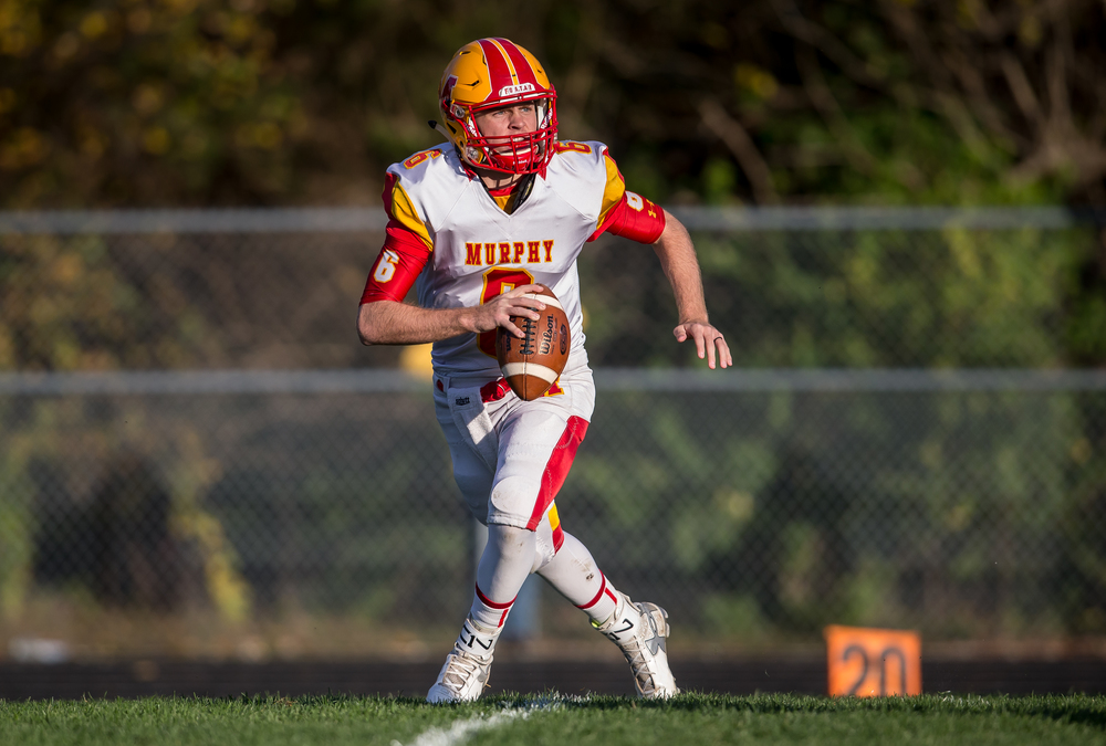 Murphysboro quarterback Braden Miller (6) scrambles out of the pocket as he looks for a receiver against Rochester in the second quarter during the second round of the Class 4A playoffs at Rochester High School, Saturday, Nov. 7, 2015, in Rochester, Ill. Justin L. Fowler/The State Journal-Register