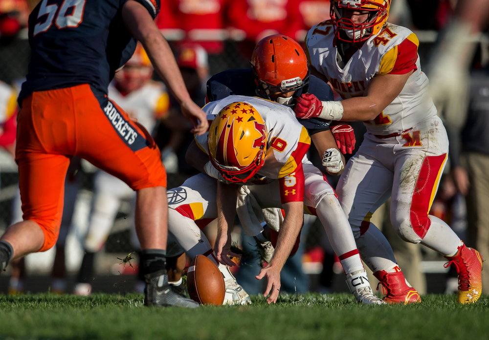 Murphysboro quarterback Braden Miller (6) fumbles the ball under pressure from Rochester's Avante' Cox (5) in the second quarter during the second round of the Class 4A playoffs at Rochester High School, Saturday, Nov. 7, 2015, in Rochester, Ill. Justin L. Fowler/The State Journal-Register