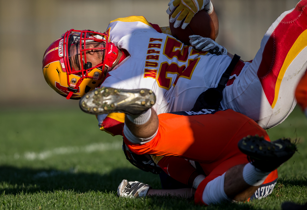 Murphysboro's Kane Toliver (25) is brought down by a Rochester defender on a rush in the second quarter during the second round of the Class 4A playoffs at Rochester High School, Saturday, Nov. 7, 2015, in Rochester, Ill. Justin L. Fowler/The State Journal-Register