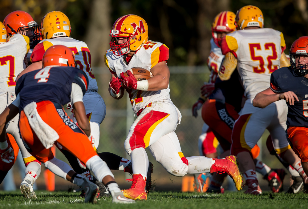 Murphysboro's Clay Rendleman (47) breaks through a hole in the Rochester defense to gain yardage on a rush in the second quarter during the second round of the Class 4A playoffs at Rochester High School, Saturday, Nov. 7, 2015, in Rochester, Ill. Justin L. Fowler/The State Journal-Register
