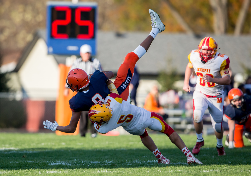 Murphysboro's Staci Labranche (5) flips Rochester's Collin Stallworth (8) over as he brings him down after a catch in the second quarter during the second round of the Class 4A playoffs at Rochester High School, Saturday, Nov. 7, 2015, in Rochester, Ill. Justin L. Fowler/The State Journal-Register