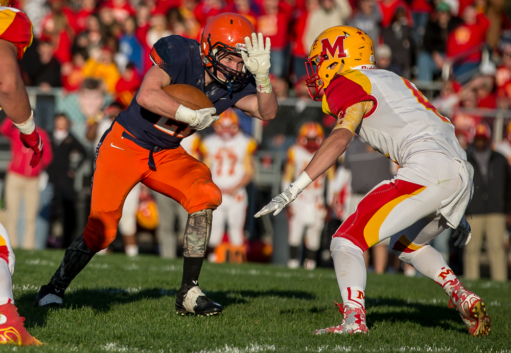 Rochester's Kenny Hedges (21) tries to spin out of a tackle from Murphysboro's Zack Easton (4) on a rush in the second quarter during the second round of the Class 4A playoffs at Rochester High School, Saturday, Nov. 7, 2015, in Rochester, Ill. Justin L. Fowler/The State Journal-Register