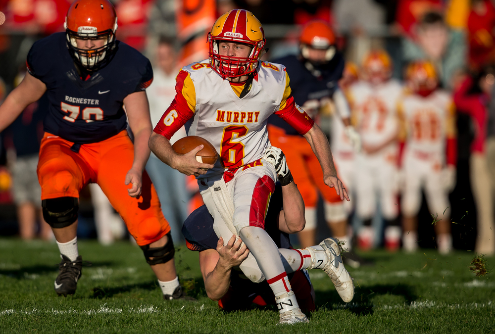 Murphysboro quarterback Braden Miller (6) is brought down by Rochester's Brandon Jones (50) from behind for a lose in the second quarter during the second round of the Class 4A playoffs at Rochester High School, Saturday, Nov. 7, 2015, in Rochester, Ill. Justin L. Fowler/The State Journal-Register