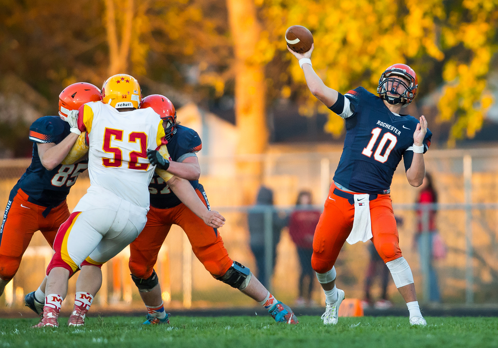 Rochester quarterback Danny Zeigler (10) launches a pass with protection from his lineman against Murphysboro in the third quarter during the second round of the Class 4A playoffs at Rochester High School, Saturday, Nov. 7, 2015, in Rochester, Ill. Justin L. Fowler/The State Journal-Register