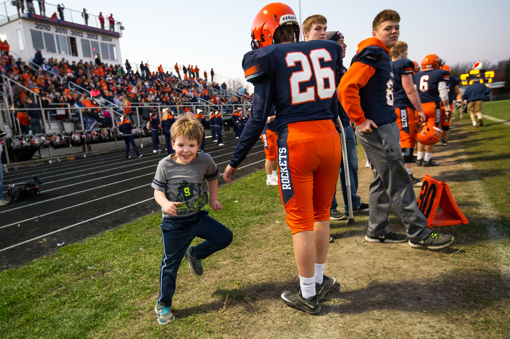 Blake Leonard, 4, the son of Rochester head coach Derek Leonard, keeps the sidelines active as the Rockets take on Murphysboro in the third quarter during the second round of the Class 4A playoffs at Rochester High School, Saturday, Nov. 7, 2015, in Rochester, Ill. Justin L. Fowler/The State Journal-Register