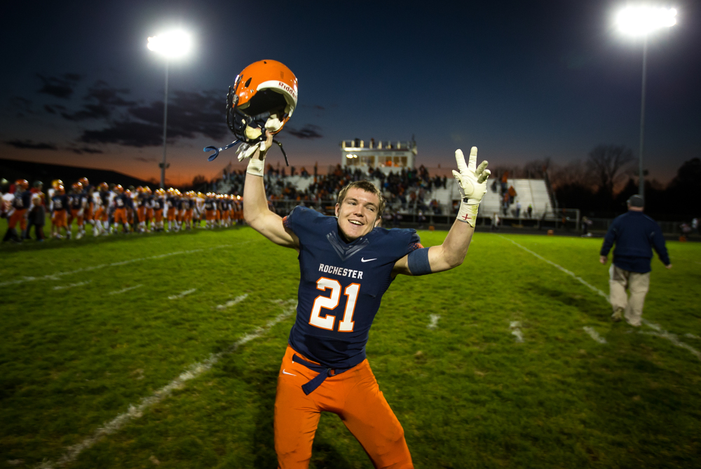 Rochester's Kenny Hedges (21) begins to celebrate after the Rockets defeated Murphysboro 47-20 in the second round of the Class 4A playoffs at Rochester High School, Saturday, Nov. 7, 2015, in Rochester, Ill. Justin L. Fowler/The State Journal-Register