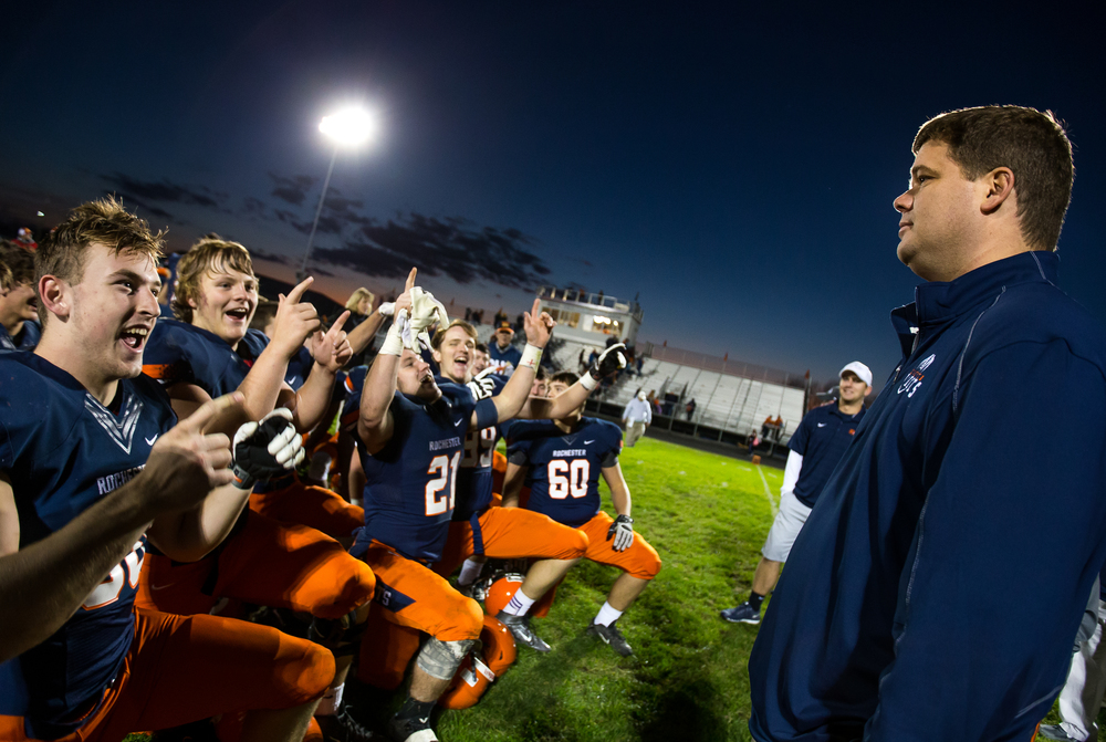 "The Rochester Rockets serenade head coach Derek Leonard with ""Sweet Caroline"" after the Rockets defeated Murphysboro 47-20 in the second round of the Class 4A playoffs at Rochester High School, Saturday, Nov. 7, 2015, in Rochester, Ill. Justin L. Fowler/The State Journal-Register"