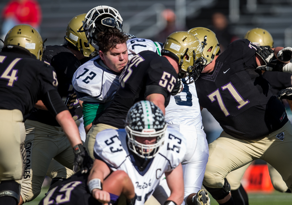 Peoria Notre Dame's Jett Schmitt (72) loses his helmet trying to block for Peoria Notre Dame's Alex Shaw (3) on a rush against Sacred Heart-Griffin in the first quarter during the second round of the Class 6A playoffs at the Sacred Heart-Griffin Sports Complex, Saturday, Nov. 7, 2015, in Springfield, Ill. Justin L. Fowler/The State Journal-Register