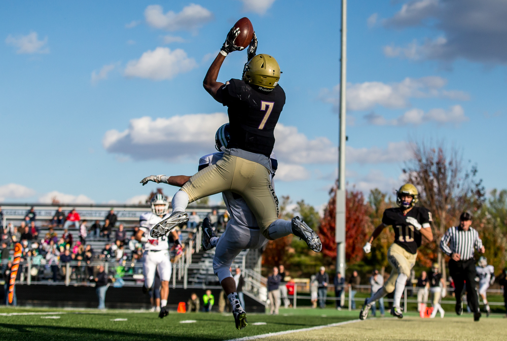 Sacred Heart-Griffin's Avery Andrews (7) pulls in a touchdown pass over Peoria Notre Dame's Nico Shadid (21) in the third quarter during the second round of the Class 6A playoffs at the Sacred Heart-Griffin Sports Complex, Saturday, Nov. 7, 2015, in Springfield, Ill. Justin L. Fowler/The State Journal-Register