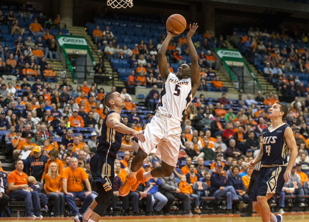 University of Illinois' Jalen Coleman-Lands (5) puts up a basket as he draws a foul from University of Illinois Springfield's JJ Cravatta (11) in the first half during an exhibition game at the Prairie Capital Convention Center, Sunday, Nov. 8, 2015, in Springfield, Ill. Coleman-Lands led the Illiini in scoring with 20 points and five 3-pointers. Justin L. Fowler/The State Journal-Register