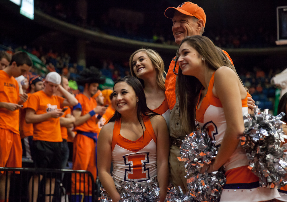 Illinois Gov. Bruce Rauner poses for a picture with the University of Illinois Illinettes on the sidelines as the University of Illinois takes on the University of Illinois Springfield during an exhibition game at the Prairie Capital Convention Center, Sunday, Nov. 8, 2015, in Springfield, Ill. Justin L. Fowler/The State Journal-Register