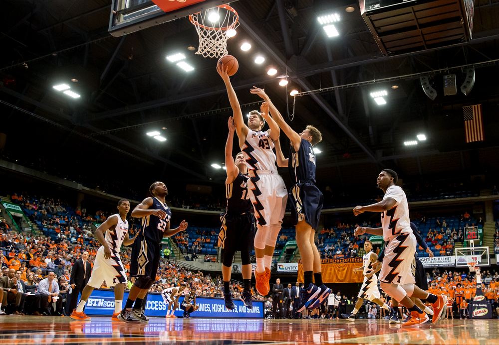 University of Illinois' Michael Finke (43) drives up to the basket for two points against University of Illinois Springfield's Zach Steinberg (21) in the second half during an exhibition game at the Prairie Capital Convention Center, Sunday, Nov. 8, 2015, in Springfield, Ill. Justin L. Fowler/The State Journal-Register
