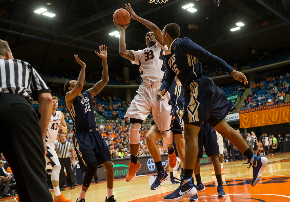 University of Illinois' Mike Thorne Jr. (33) battles underneath the basket for a shot against the University of Illinois Springfield in the second half during an exhibition game at the Prairie Capital Convention Center, Sunday, Nov. 8, 2015, in Springfield, Ill. Justin L. Fowler/The State Journal-Register