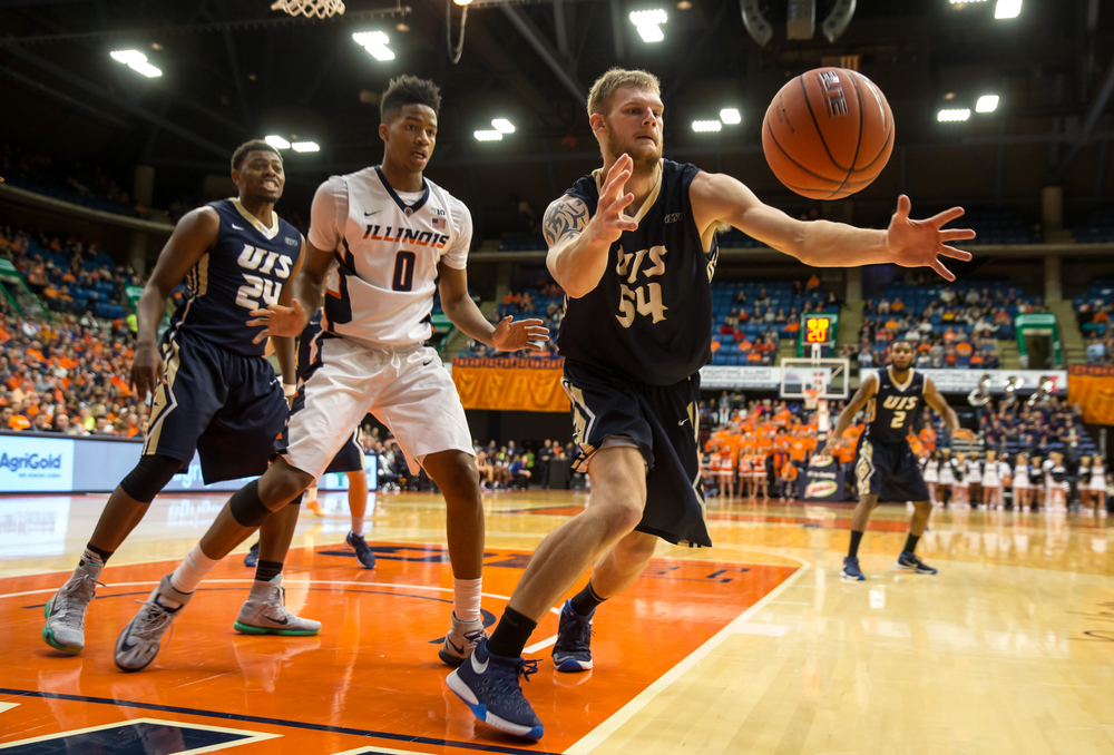 University of Illinois Springfield's Jesse Tesmer (54) tries to save a ball from going out-of-bounds against University of Illinois' D.J. Williams (0) in the second half during an exhibition game at the Prairie Capital Convention Center, Sunday, Nov. 8, 2015, in Springfield, Ill. Justin L. Fowler/The State Journal-Register
