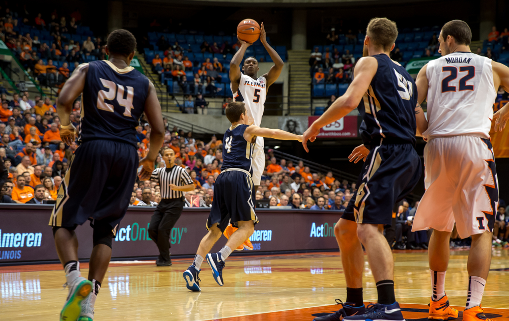 University of Illinois' Jalen Coleman-Lands (5) fires off a 3-pointer against University of Illinois Springfield's Logan Gonce (4) in the second half during an exhibition game at the Prairie Capital Convention Center, Sunday, Nov. 8, 2015, in Springfield, Ill. Justin L. Fowler/The State Journal-Register