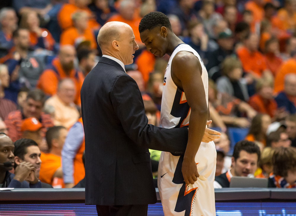 University of Illinois head coach John Groce gives Jalen Coleman-Lands (5) a pat on the back as he comes off the floor with 20 points again the University of Illinois Springfield during an exhibition game at the Prairie Capital Convention Center, Sunday, Nov. 8, 2015, in Springfield, Ill. Justin L. Fowler/The State Journal-Register