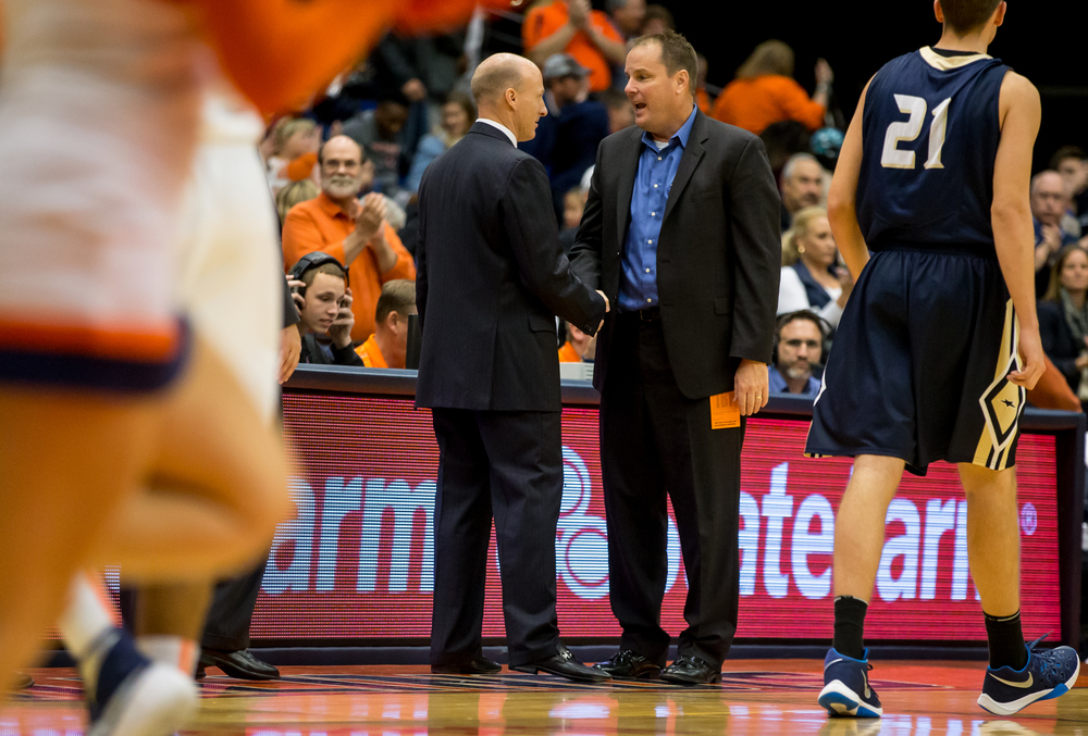 University of Illinois Springfield head coach Bill Walker, right, shakes hands with University of Illinois head coach John Groce after the Illini defeated the Prairie Stars 104-69 during an exhibition game at the Prairie Capital Convention Center, Sunday, Nov. 8, 2015, in Springfield, Ill. Justin L. Fowler/The State Journal-Register