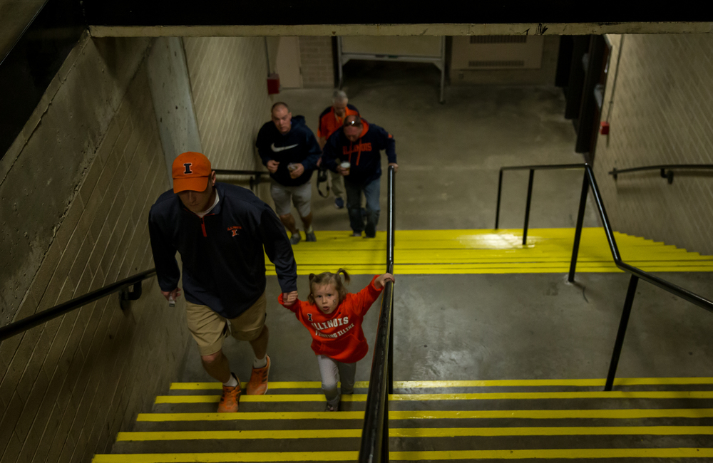 Mark Ruscin, and his daughter Hannah, 4, head up the stairs to take their seats for the University of Illinois vs. the University of Illinois Springfield exhibition game at the Prairie Capital Convention Center, Sunday, Nov. 8, 2015, in Springfield, Ill. Justin L. Fowler/The State Journal-Register