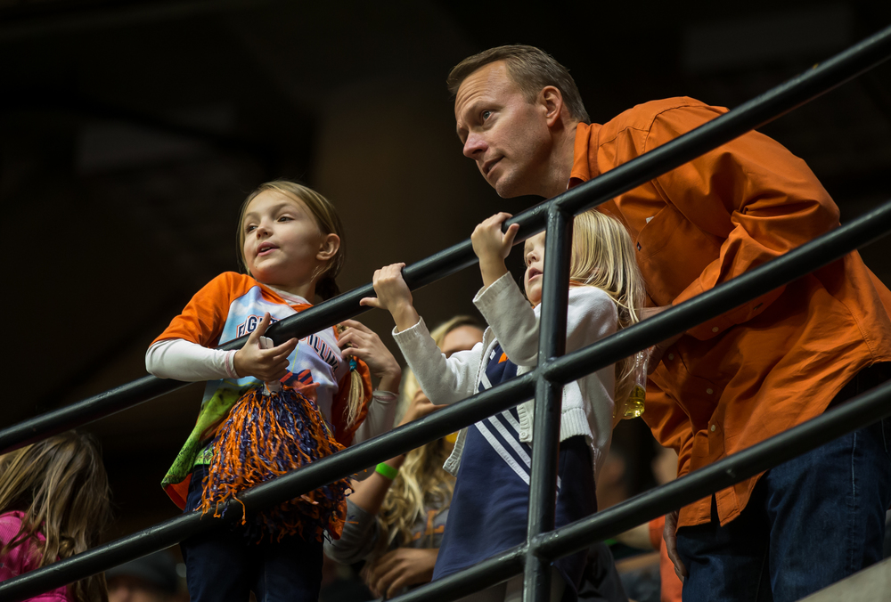 Mike Johnson, right, looks out on to the court with his daughters, Alina, 4, and Bella, 8, as the University of Illinois takes the court to take on the University of Illinois Springfield for an exhibition game at the Prairie Capital Convention Center, Sunday, Nov. 8, 2015, in Springfield, Ill. Justin L. Fowler/The State Journal-Register