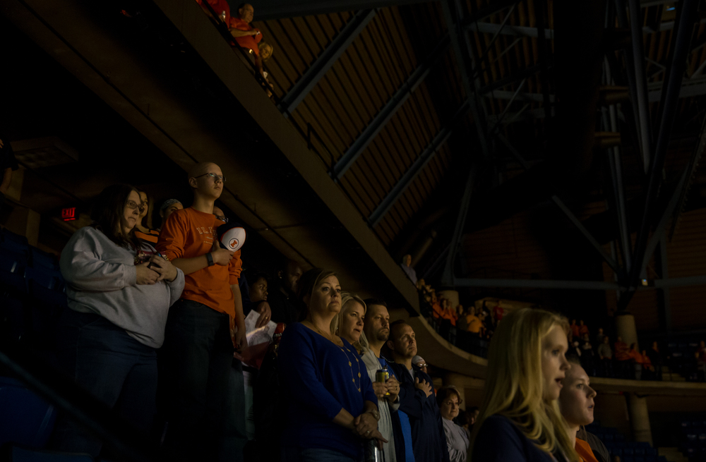 Fans stand as the National Anthem is played prior to players introductions for the University of Illinois vs. the University of Illinois Springfield exhibition game at the Prairie Capital Convention Center, Sunday, Nov. 8, 2015, in Springfield, Ill. Justin L. Fowler/The State Journal-Register