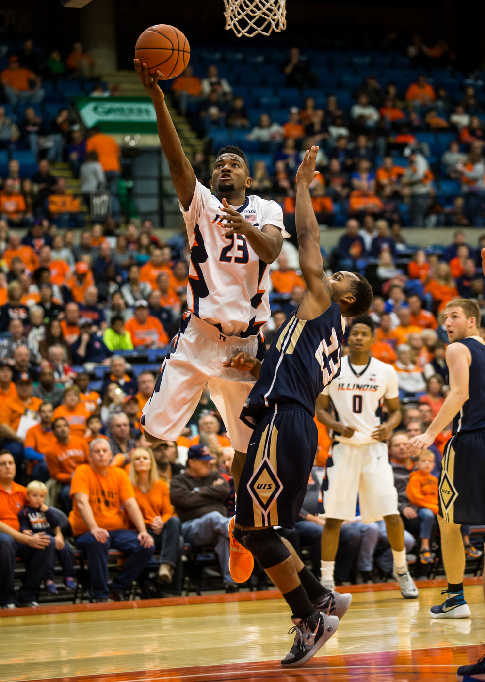 University of Illinois' Aaron Jordan (23) goes up for a basket against University of Illinois Springfield's Mark Weems (23) in the first half during an exhibition game at the Prairie Capital Convention Center, Sunday, Nov. 8, 2015, in Springfield, Ill. Justin L. Fowler/The State Journal-Register