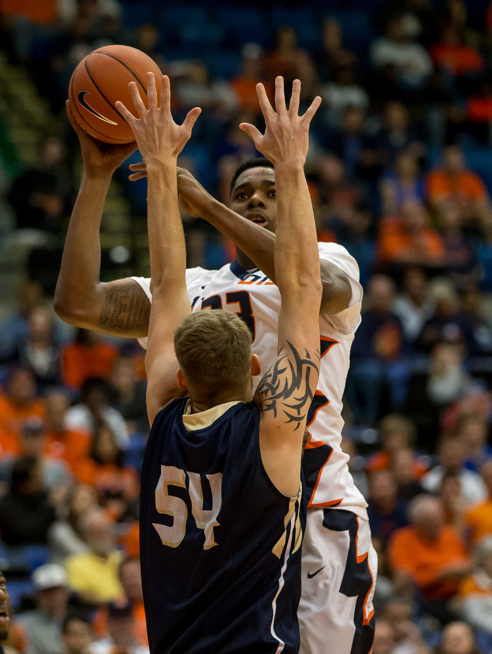 University of Illinois' Mike Thorne Jr. (33) puts up a shot against University of Illinois Springfield's Jesse Tesmer (54) in the first half during an exhibition game at the Prairie Capital Convention Center, Sunday, Nov. 8, 2015, in Springfield, Ill. Justin L. Fowler/The State Journal-Register