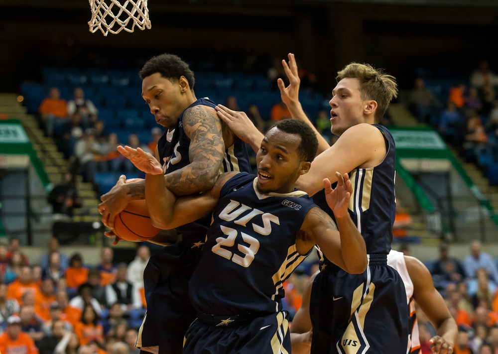 University of Illinois Springfield's Richard Freeman (22) comes down with a rebound underneath the basket with his teammates against the University of Illinois in the first half during an exhibition game at the Prairie Capital Convention Center, Sunday, Nov. 8, 2015, in Springfield, Ill. Justin L. Fowler/The State Journal-Register