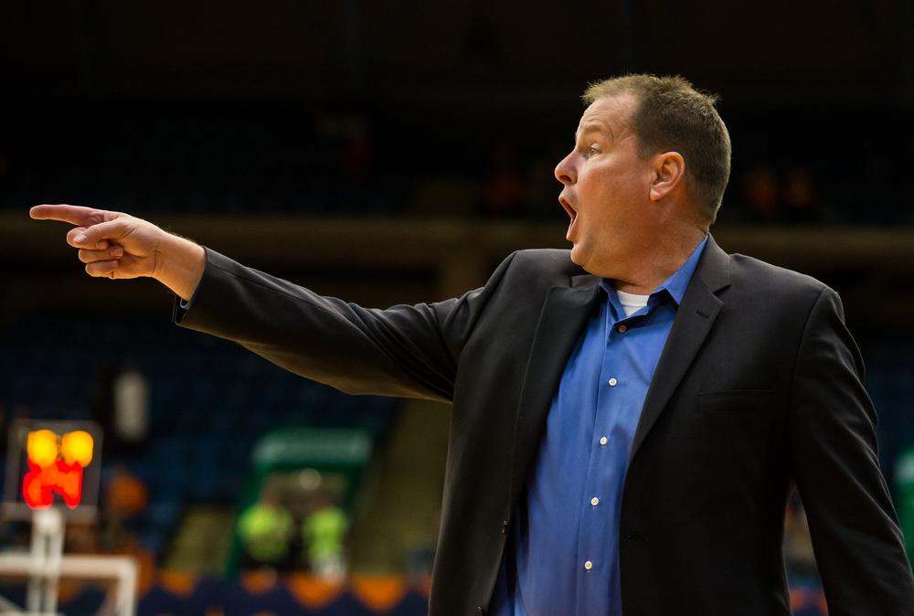 University of Illinois Springfield head coach Bill Walker calls out instructions to his team as they take on the Unviersity of Illinois in the first half during an exhibition game at the Prairie Capital Convention Center, Sunday, Nov. 8, 2015, in Springfield, Ill. Justin L. Fowler/The State Journal-Register