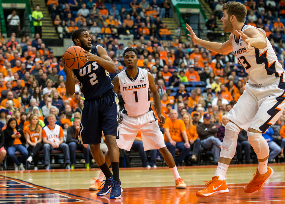 University of Illinois Springfield's Davi Austin (2) looks for an outlet as he saves a ball from going out-of-bounds against the University of Illinois in the first half during an exhibition game at the Prairie Capital Convention Center, Sunday, Nov. 8, 2015, in Springfield, Ill. Justin L. Fowler/The State Journal-Register