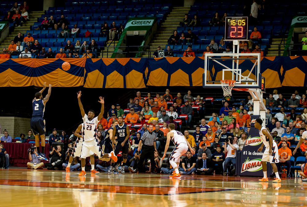 University of Illinois Springfield's Davi Austin (2) launches a 3-pointer against the University of Illinois in the first half during an exhibition game at the Prairie Capital Convention Center, Sunday, Nov. 8, 2015, in Springfield, Ill. Justin L. Fowler/The State Journal-Register