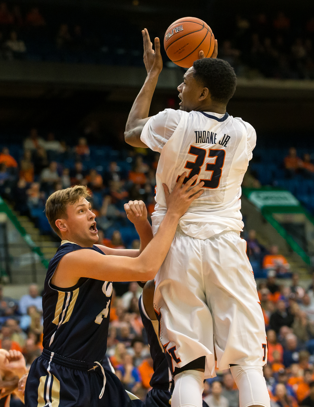 University of Illinois' Mike Thorne Jr. (33) draws the foul from University of Illinois Springfield's Zach Steinberg (21) as he goes up for a shot in the first half during an exhibition game at the Prairie Capital Convention Center, Sunday, Nov. 8, 2015, in Springfield, Ill. Justin L. Fowler/The State Journal-Register