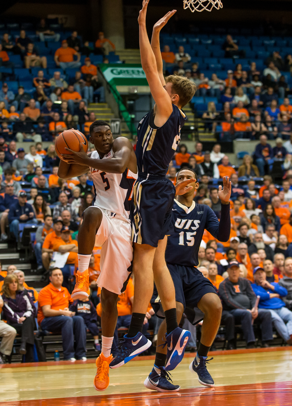 University of Illinois' Jalen Coleman-Lands (5) collides with University of Illinois Springfield's Zach Steinberg (21) underneath the basket as he looks for an outlet pass in the first half during an exhibition game at the Prairie Capital Convention Center, Sunday, Nov. 8, 2015, in Springfield, Ill. Justin L. Fowler/The State Journal-Register