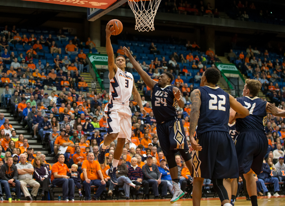 University of Illinois' Khalid Lewis (3) goes in for a basket against University of Illinois Springfield's Jamall Millison (24) in the first half during an exhibition game at the Prairie Capital Convention Center, Sunday, Nov. 8, 2015, in Springfield, Ill. Justin L. Fowler/The State Journal-Register